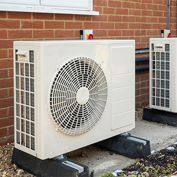 air source heat pump outside of a house