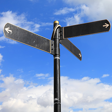 Picture of signpost, with three pointers facing in different directions.