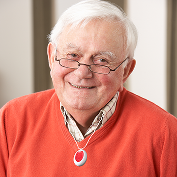Picture of a smiling older man, who is wearing a Ryecare Lifeline.